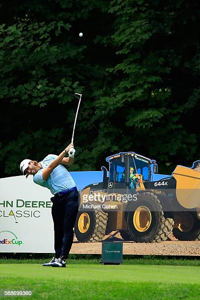 Andrew Loupe plays a shot on the 17th hole during the continuation of the first round of the John Deere Classic at TPC Deere Run on August 12 2016 in...
