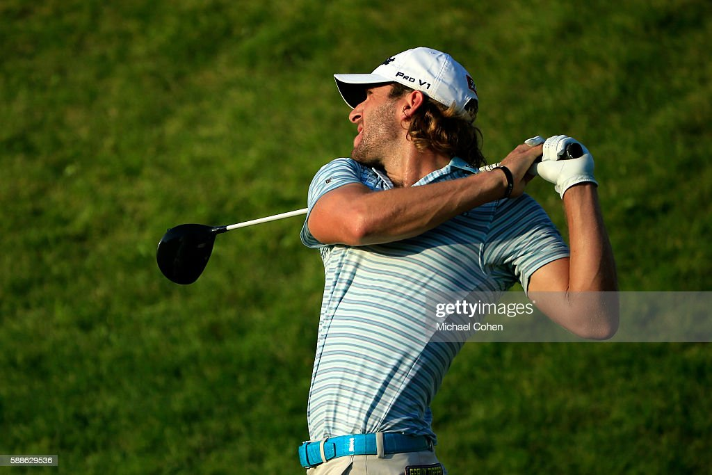 Andrew Loupe plays his shot from the tenth hole during the first round of the John Deere Classic at TPC Deere Run on August 11, 2016 in Silvis, Illinois.