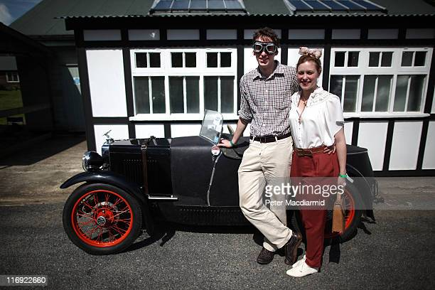 Andrew Lovett and Katrina Bowles pose in front of their 1932 MType MG at The Brooklands Double Twelve Motorsport Festival on June 18 2011 in...