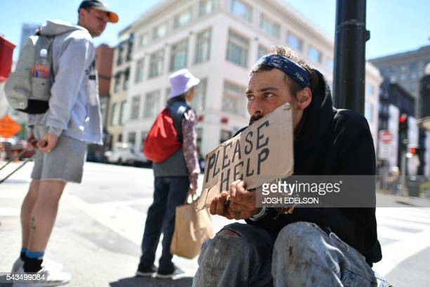 Andrew Loy begs along a sidewalk in downtown San Francisco California on Tuesday June 2016 Homelessness is on the rise in the city irking residents...