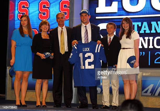 Andrew Luck #1 overall pick by the Indianapolis Colts out of Stanford holds up a Colts jersey as he poses on stage with his father Oliver mother...