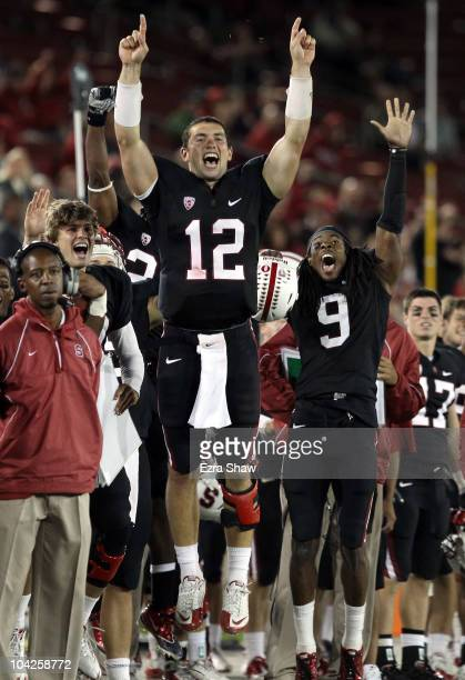 Andrew Luck and Richard Sherman of the Stanford Cardinal celebrate from the sidelines after Stanford scored a touchdown to go up 67-24 in the fourth...
