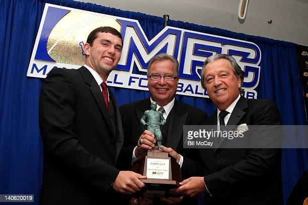 Andrew Luck from Stanford University and winner of the 75th Annual Maxwell Award for College Player of the Year accepts his award from Ron Jaworski...