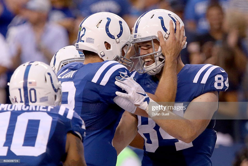 Andrew Luck #12 of the Indianapolis Colts and Jack Doyle #84 of the Indianapolis Colts celebrate after the two connected for a touchdown in the fourth quarter to take the lead in the game against the Detroit Lions at Lucas Oil Stadium on September 11, 2016 in Indianapolis, Indiana.