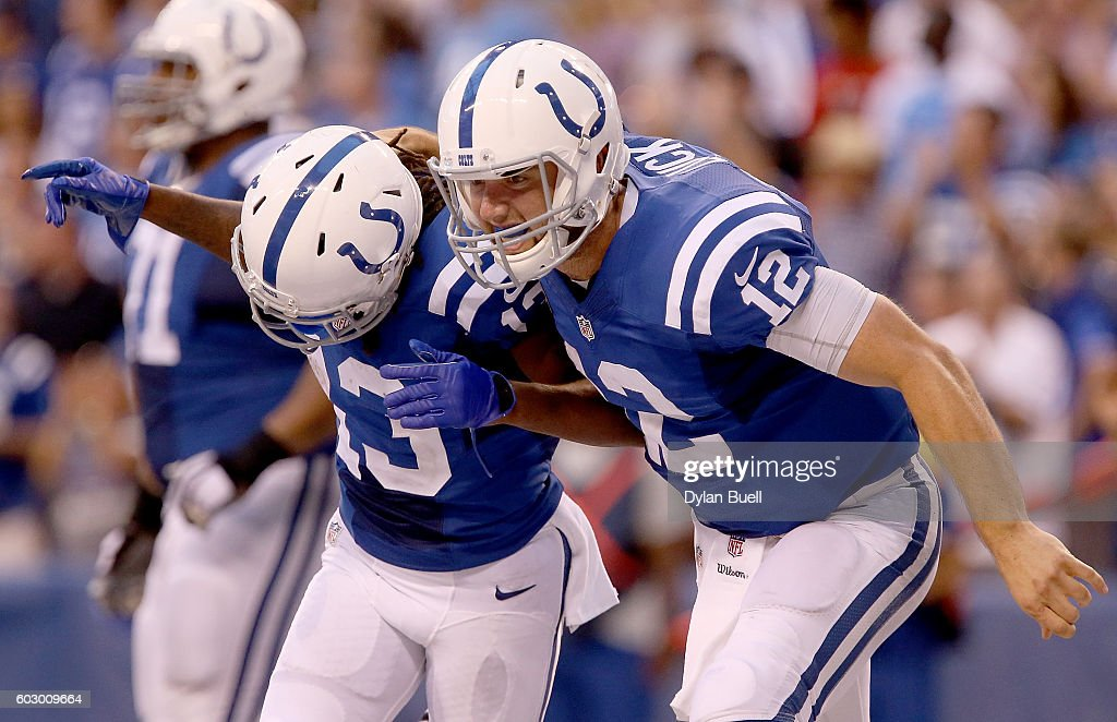Andrew Luck #12 of the Indianapolis Colts and T.Y. Hilton #13 of the Indianapolis Colts celebrate after the Colts took the lead in the fourth quarter of the game against the Detroit Lions at Lucas Oil Stadium on September 11, 2016 in Indianapolis, Indiana.