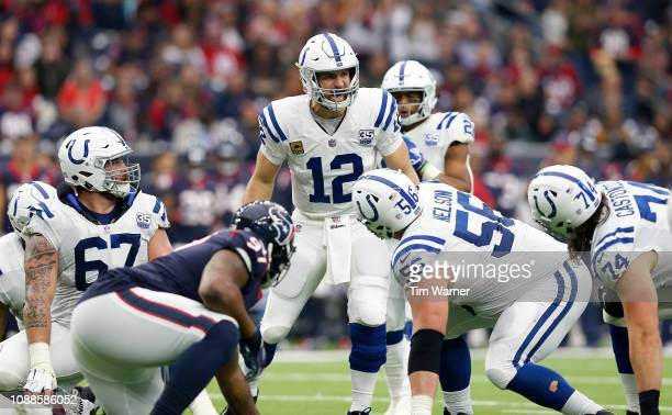 Andrew Luck of the Indianapolis Colts calls a play at the line of scrimmage in the first half against the Houston Texans at NRG Stadium on December 9...