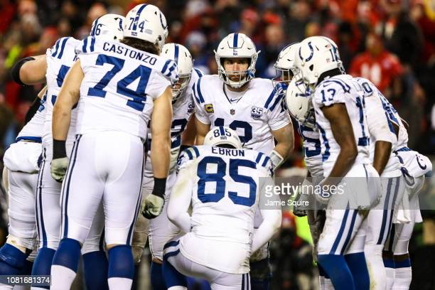 Andrew Luck of the Indianapolis Colts calls a play in the huddle during the fourth quarter of the AFC Divisional Round playoff game against the...