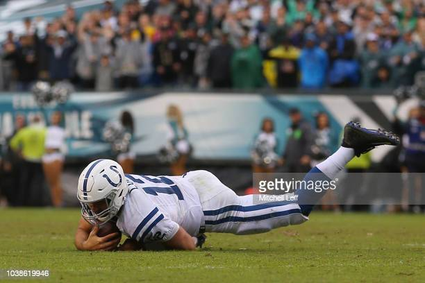 Andrew Luck of the Indianapolis Colts falls after being sacked by defensive end Derek Barnett of the Philadelphia Eagles in the final minutes of the...
