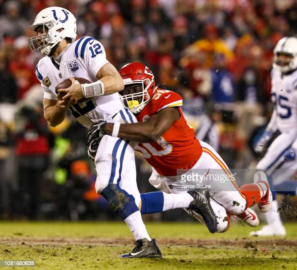 Andrew Luck of the Indianapolis Colts is sacked by Justin Houston of the Kansas City Chiefs during the third quarter of the AFC Divisional Round...