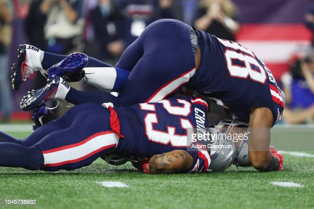 Andrew Luck of the Indianapolis Colts is sacked by Trey Flowers and Patrick Chung of the New England Patriots during the first half at Gillette...