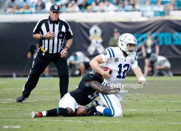 Andrew Luck of the Indianapolis Colts is sacked by Yannick Ngakoue of the Jacksonville Jaguars during a game at TIAA Bank Field on December 2 2018 in...