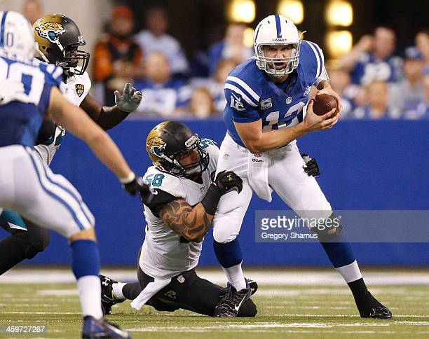 Andrew Luck of the Indianapolis Colts is sacked during the second quarter by Jason Babin of the Jacksonville Jaguars at Lucas Oil Stadium on December...