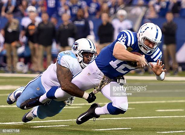 Andrew Luck of the Indianapolis Colts is tackled by Jurrell Casey of the Tennessee Titans in the first quarter of the game at Lucas Oil Stadium on...