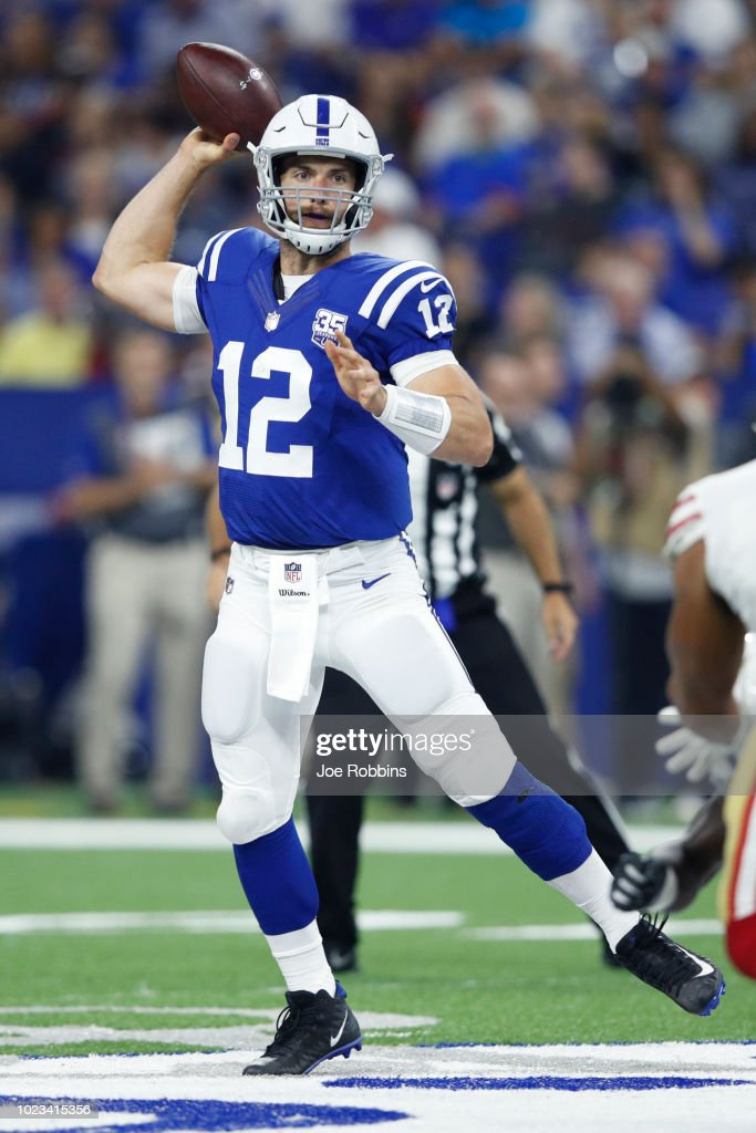 Andrew Luck #12 of the Indianapolis Colts looks to pass the ball against the San Francisco 49ers in the first quarter of a preseason game at Lucas Oil Stadium on August 25, 2018 in Indianapolis, Indiana.