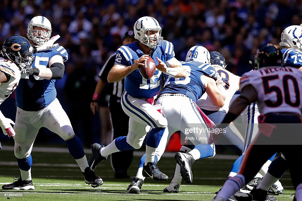 Andrew Luck #12 of the Indianapolis Colts runs away from pressure during the first quarter of the game against the Chicago Bears at Lucas Oil Stadium on October 9, 2016 in Indianapolis, Indiana.