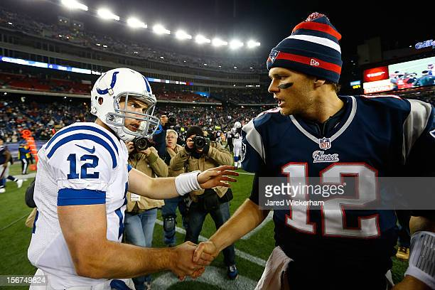Andrew Luck of the Indianapolis Colts shakes hands with Tom Brady of the New England Patriots following their game on November 18 2012 at Gillette...