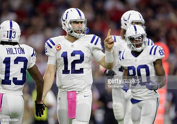 Andrew Luck of the Indianapolis Colts signals toward the sideline in the fourth quarter during the NFL game between the Indianapolis Colts and the...