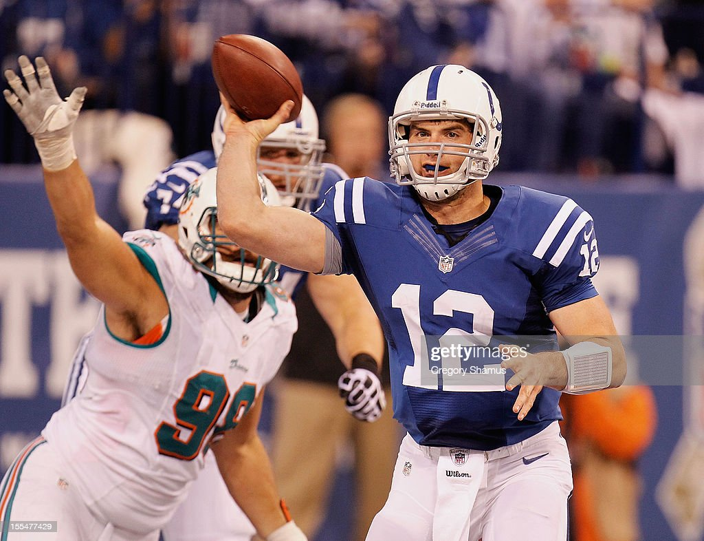 Andrew Luck #12 of the Indianapolis Colts throws a fourth quarter pass while playing the Miami Dolphins at Lucas Oil Stadium on November 4, 2012 in Indianapolis, Indiana. Indianapolis won the game 23-20.
