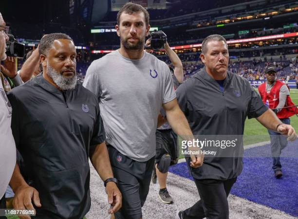 Andrew Luck of the Indianapolis Colts walks off the field following reports of his retirement from the NFL after the preseason game against the...