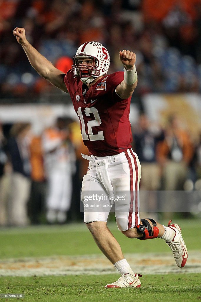Andrew Luck #12 of the Stanford Cardinal celebrates after he threw a 38-yard touchdown pass in the fourth quarter against the Virginia Tech Hokies during the 2011 Discover Orange Bowl at Sun Life Stadium on January 3, 2011 in Miami, Florida. Stanford won 40-12.
