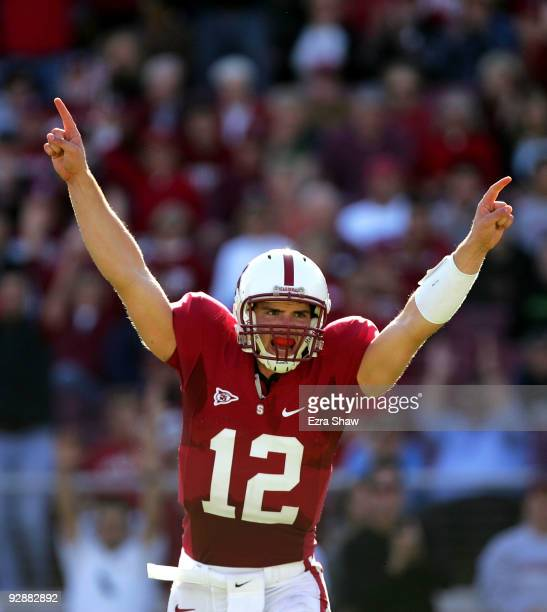 Andrew Luck of the Stanford Cardinal celebrates after the Cardinals scored a touchdown to go up 3014 over the Oregon Ducks at Stanford Stadium on...