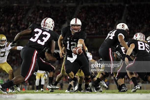 Andrew Luck of the Stanford Cardinal hands the ball off to Stepfan Taylor of the Stanford Cardinal during their game against the UCLA Bruins at...