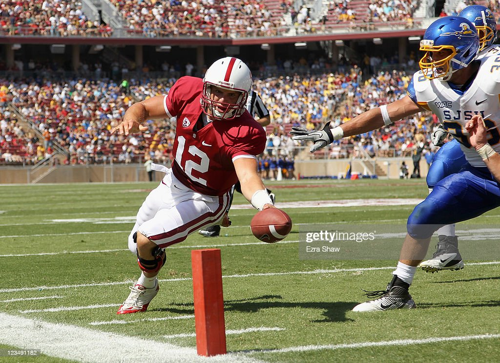 Andrew Luck #12 of the Stanford Cardinal runs in for a touchdown during the first quarter of their game against the San Jose State Spartans at Stanford Stadium on September 3, 2011 in Stanford, California.