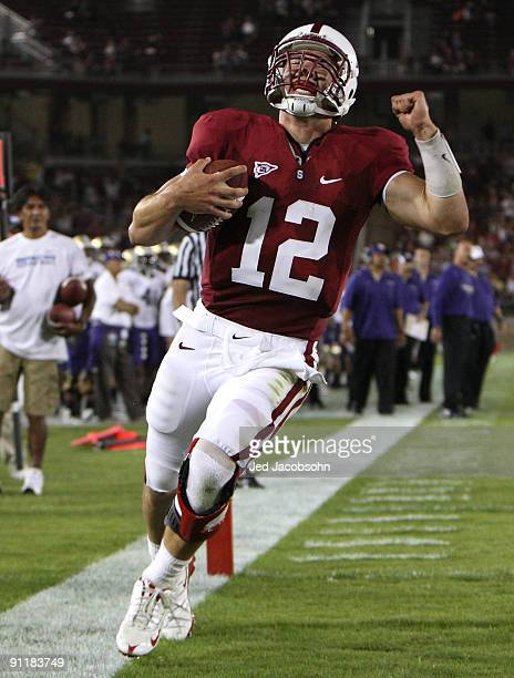 Andrew Luck of the Stanford Cardinal rushes for a touchdown in the fourth quarter against the Washington Huskies at Stanford Stadium on September 26...