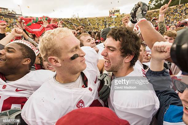 Andrew Luck quarterback of the Stanford Cardinal celebrates with teammate Konrad Reuland following the 113th Big Game between the California Golden...