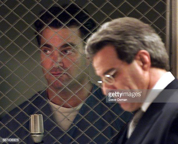 Andrew Luster 36 looks out from behind the courtroom metal fencing that separates suspects from the rest of the courtroom His attorney Joel R...