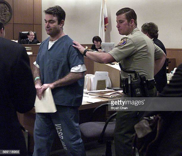 Andrew Luster left is led away after his bail hearing in Ventura County Superior Court Wednesday