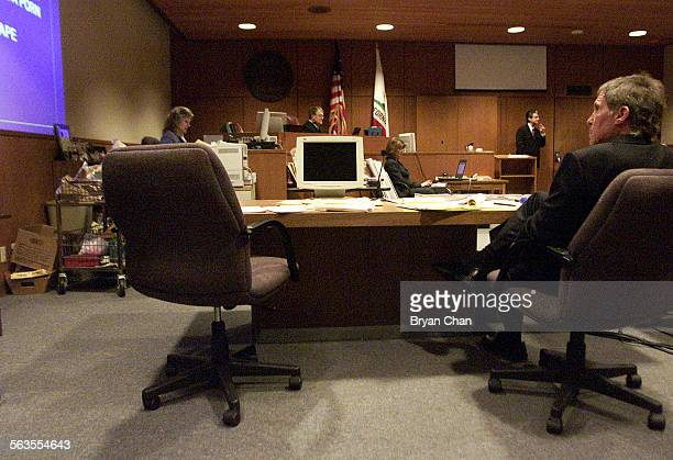 Andrew Luster's attorney Roger Diamond right sits next to an empty chair while Deputy District Attorney Tony Wold in background right makes closing...