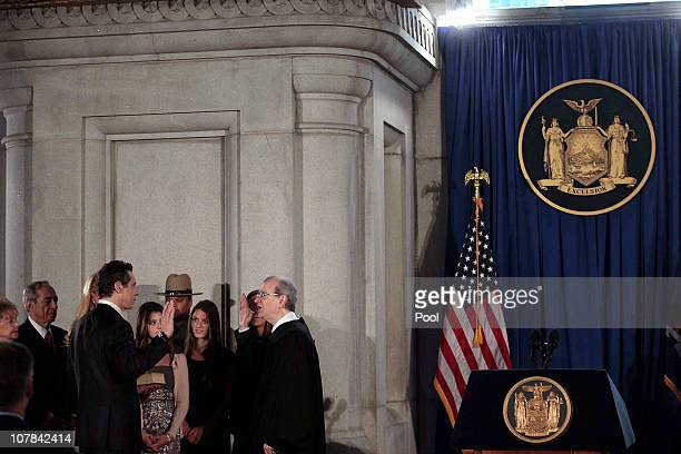 Andrew M Cuomo is sworn in as Governor of New York at his inauguration in the War Room at the state Capitol in Albany by Chief Judge of the Court of...