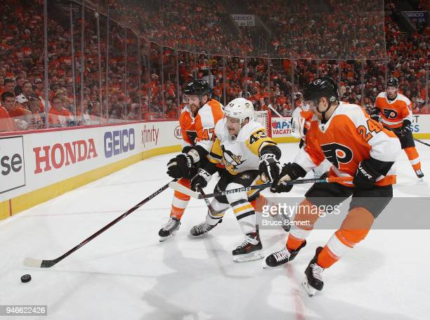 Andrew MacDonald and Matt Read of the Philadelphia Flyers defend against Conor Sheary of the Pittsburgh Penguins during the first period in Game...