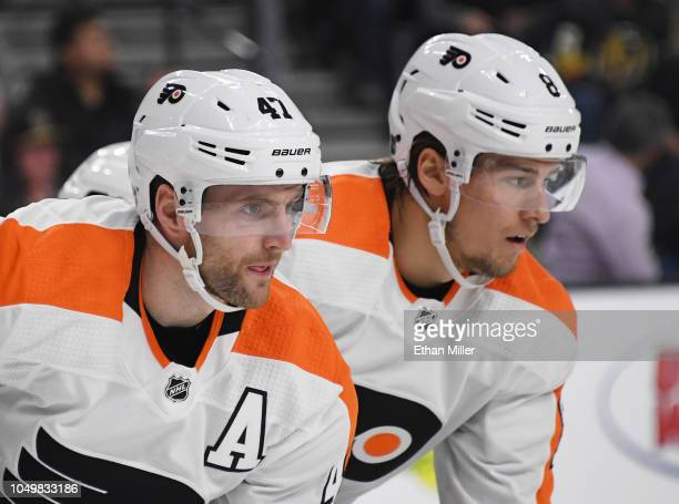 Andrew MacDonald and Robert Hagg of the Philadelphia Flyers wait for a faceoff in the second period of a game against the Vegas Golden Knights at...