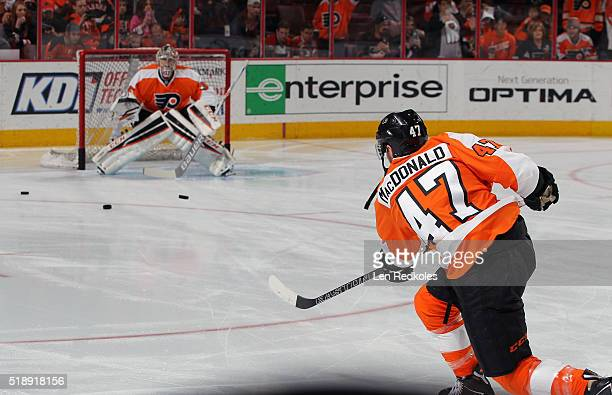 Andrew MacDonald and Steve Mason of the Philadelphia Flyers warm up prior to their game against the Winnipeg Jets on March 28 2016 at the Wells Fargo...
