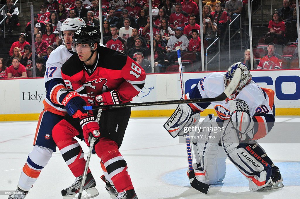 Andrew MacDonald #47 of the New York Islanders keeps Steve Bernier #18 of the New Jersey Devils out of circulation at the Prudential Center on April 1, 2013 in Newark, New Jersey. Islanders win 3-1 over the Devils.