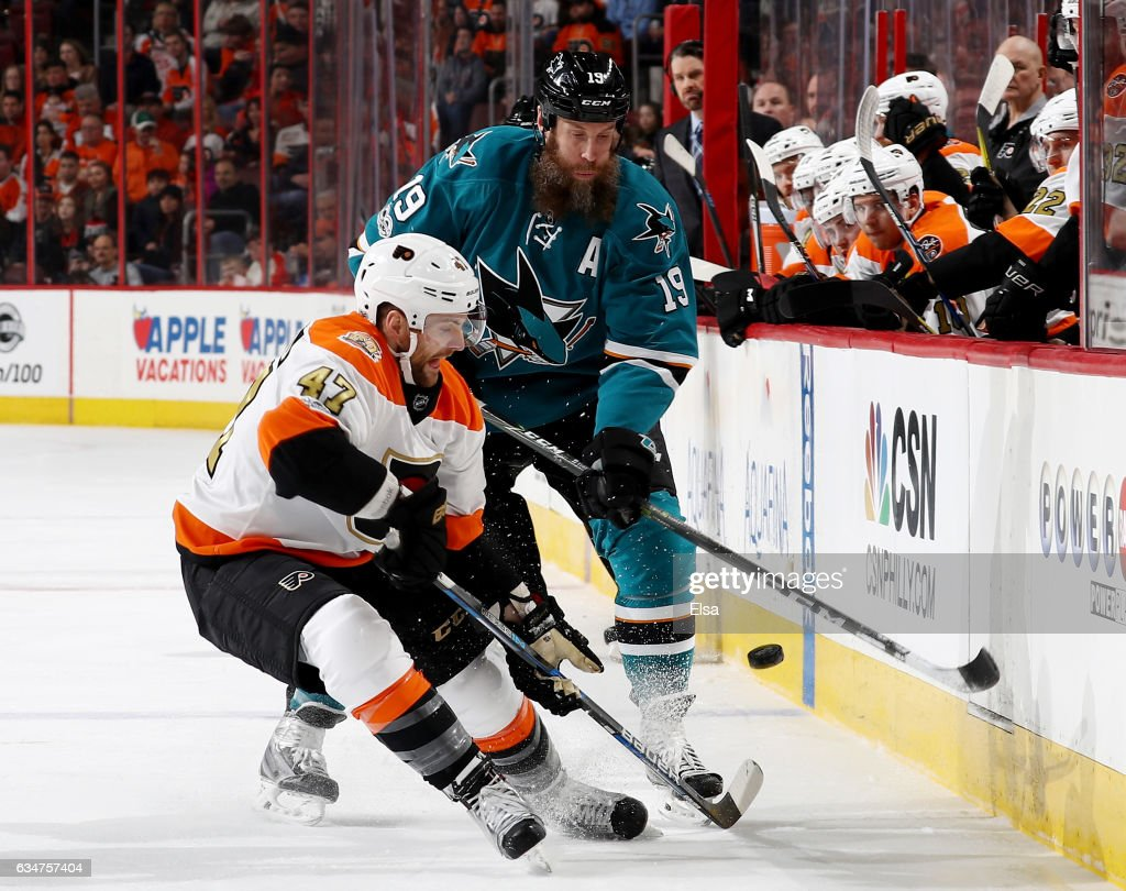 Andrew MacDonald #47 of the Philadelphia Flyers and Joe Thornton #19 of the San Jose Sharks fight for the puck in the first period on February 11, 2017 at Wells Fargo Center in Philadelphia, Pennsylvania.
