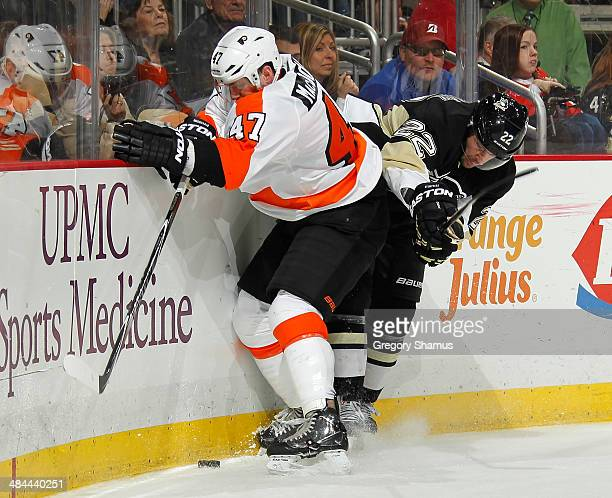 Andrew MacDonald of the Philadelphia Flyers and Lee Stempniak of the Pittsburgh Penguins battle for the puck on April 12 2014 at Consol Energy Center...