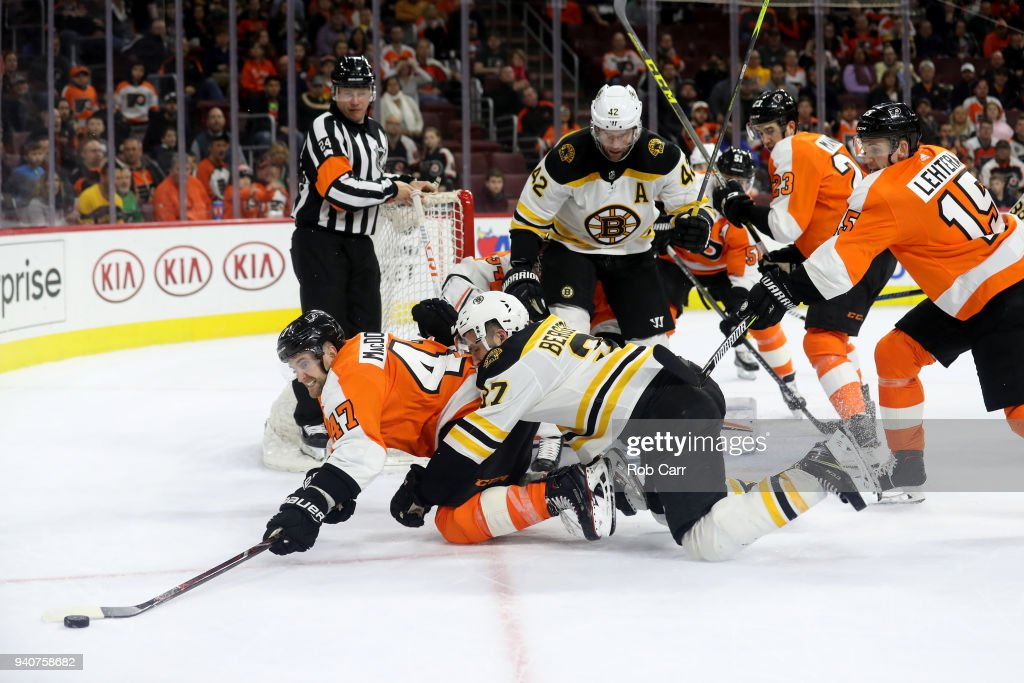 Andrew MacDonald #47 of the Philadelphia Flyers and Patrice Bergeron #37 of the Boston Bruins go after the puck in the third period at Wells Fargo Center on April 1, 2018 in Philadelphia, Pennsylvania.