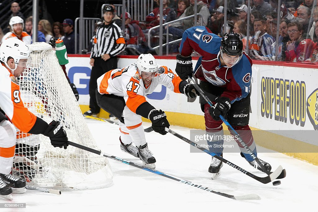 Andrew MacDonald #47 of the Philadelphia Flyers and Rene Bourque #17 of the Colorado Avalanche fight for the puck at the Pepsi Center on December 14, 2016 in Denver, Colorado.