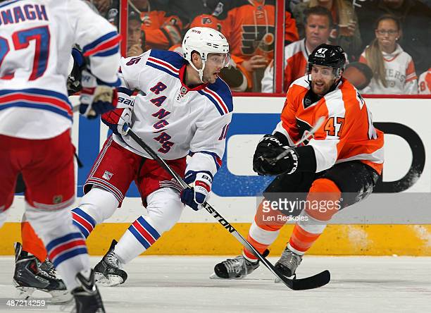 Andrew MacDonald of the Philadelphia Flyers battles against Derick Dorsett of the New York Rangers in Game Four of the First Round of the 2014...