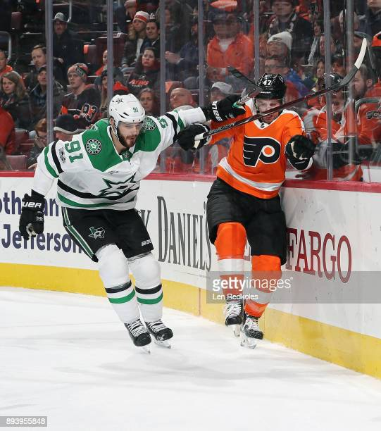 Andrew MacDonald of the Philadelphia Flyers battles for position along the boards with Tyler Seguin of the Dallas Stars on December 16 2017 at the...