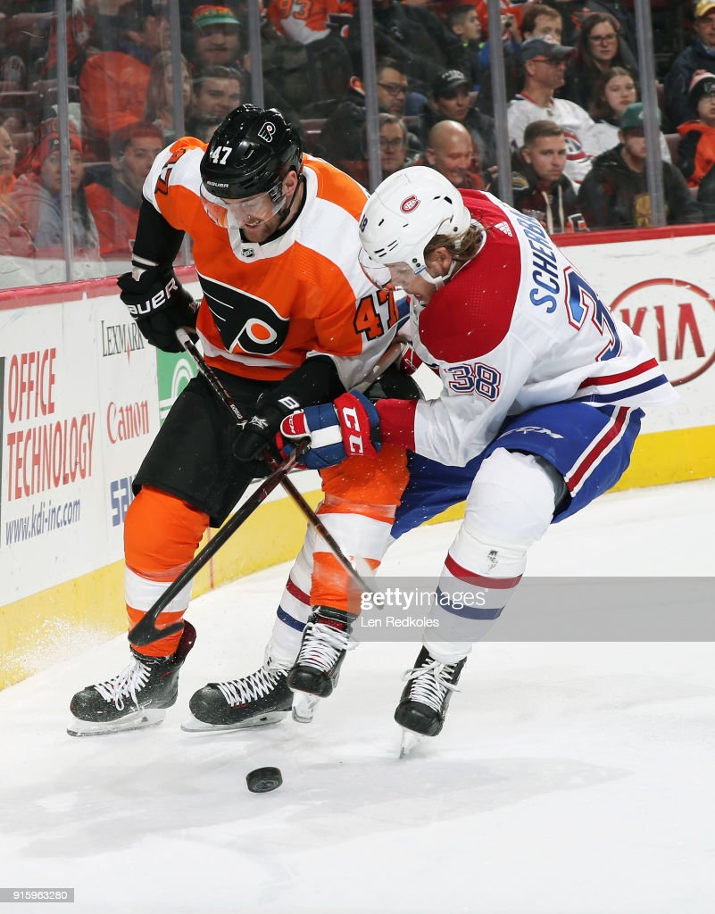 Andrew MacDonald #47 of the Philadelphia Flyers battles for the loose puck along the boards with Nikita Scherbak #38 of the Montreal Canadiens on February 8, 2018 at the Wells Fargo Center in Philadelphia, Pennsylvania. The Flyers went on to defeat the Canadiens 5-3.