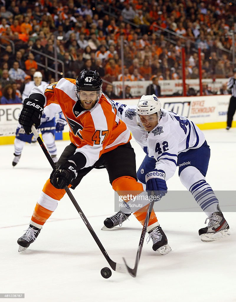 Andrew MacDonald #47 of the Philadelphia Flyers battles Tyler Bozak #42 of the Toronto Maple Leafs for the puck during the first period at Wells Fargo Center on March 28, 2014 in Philadelphia, Pennsylvania. The Flyers defeated the Maple Leafs 4-2.