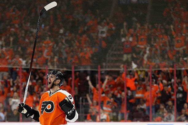 Andrew MacDonald of the Philadelphia Flyers celebrates after scoring against...