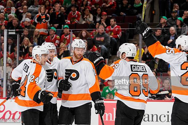 Andrew MacDonald of the Philadelphia Flyers celebrates with teammates, including Matt Read and Sean Couturier, after scoring in the first period of...