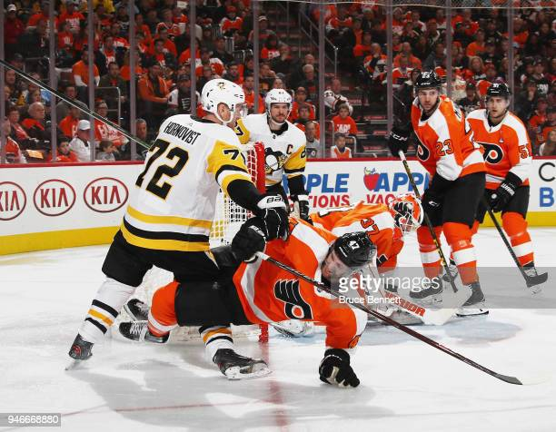 Andrew MacDonald of the Philadelphia Flyers is checked by Patric Hornqvist of the Pittsburgh Penguins during the third period in Game Three of the...