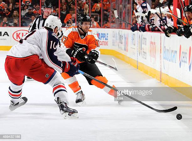 Andrew MacDonald of the Philadelphia Flyers passes the puck as Jack Skille of the Columbus Blue Jackets defends on November 22 2014 at the Wells...