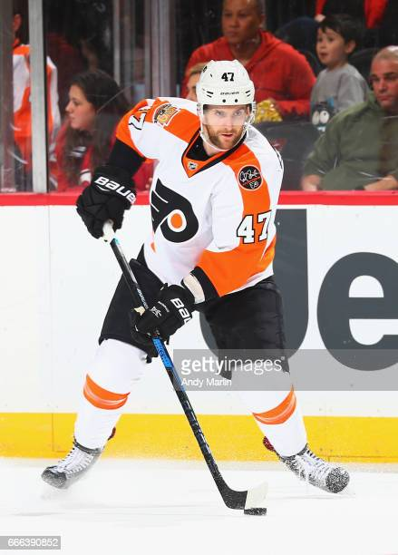 Andrew MacDonald of the Philadelphia Flyers plays the puck against the New Jersey Devils during the game at Prudential Center on April 4 2017 in...